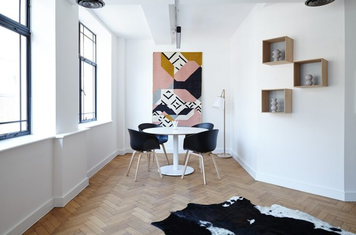 Modern white dining room & cowhide rug